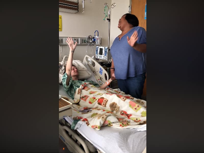 Video Of A Woman Singing Worship Songs With A Bedridden Cancer Patient Goes Viral