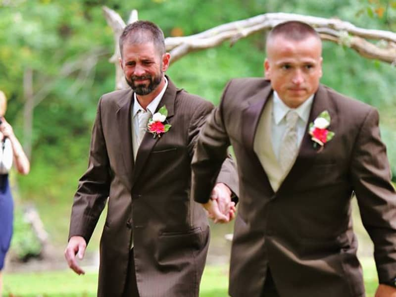 Father Of The Bride Stops Wedding Procession, Grabs Stepdad To Walk Their Daughter Down The Aisle Together