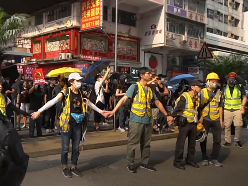 Courageous Hong Kong Christian Volunteers Mediate Between Protesters And Police