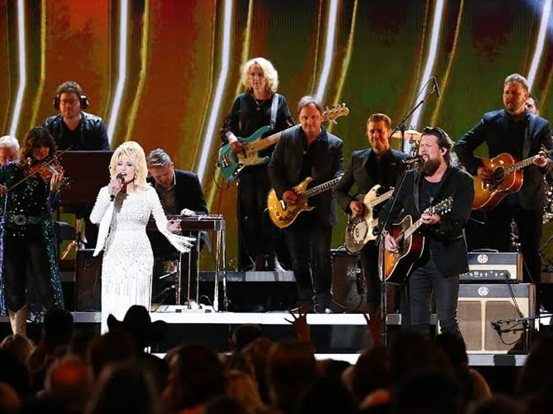 CMA Awards Guest Host Dolly Parton Brings Christian Faith On Stage
