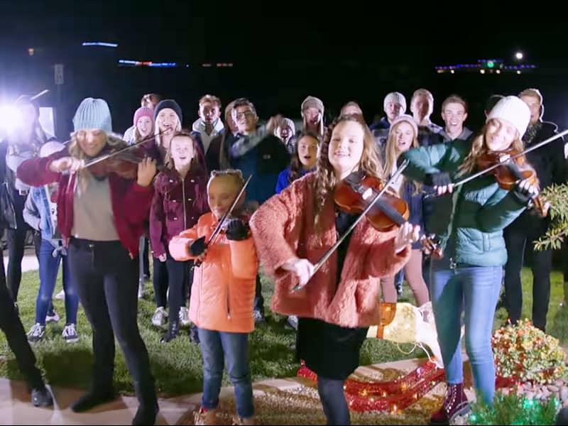 Epic Christmas Caroling Flash Mob Caught Neighborhood Off-Guard