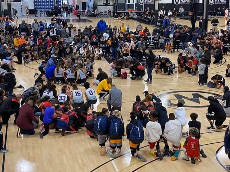 Academy Where Kobe Bryant Was Suppose To Coach Kneels In Prayer As They Receive News Of His Death