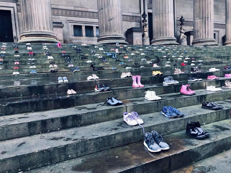 Children's Shoes Lined-Up At St. George's Hall Reveal The Reality Of Child Suicide Rates
