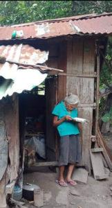 Elderly woman reads Bible