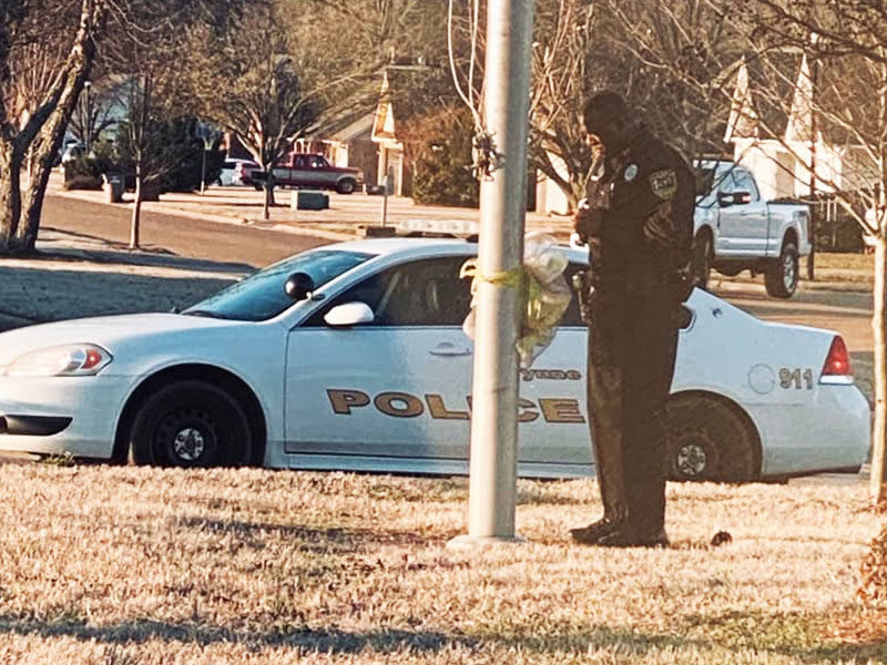 Police Officer Seen Praying Every Day At The School Flagpole