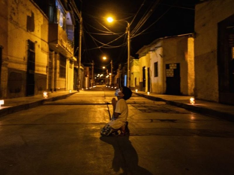 6-Year-Old Boy On His Knees In An Empty Street Praying For The End Of Pandemic