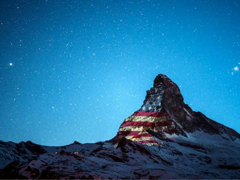 Swiss Mountain Illuminates World Flags To Offer Support During The Pandemic