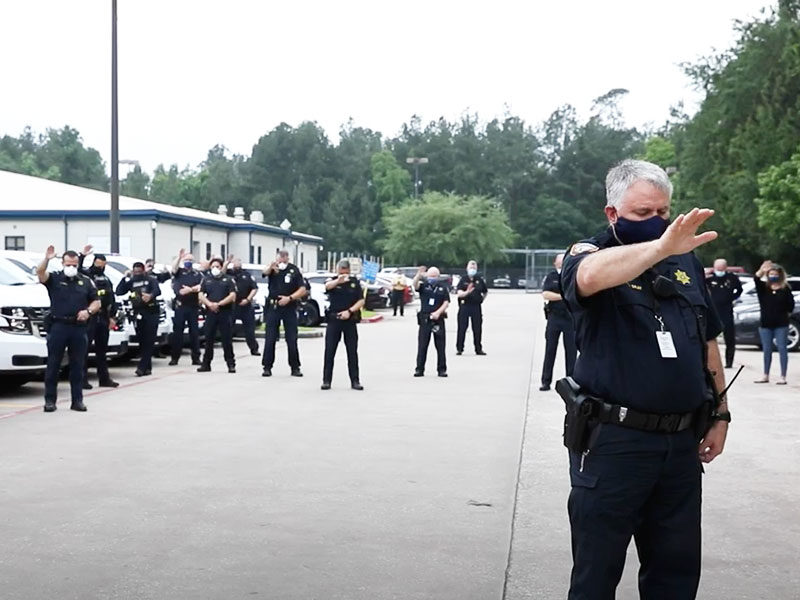 Police Officers Pray Together For Fellow Officer Affected By COVID-19