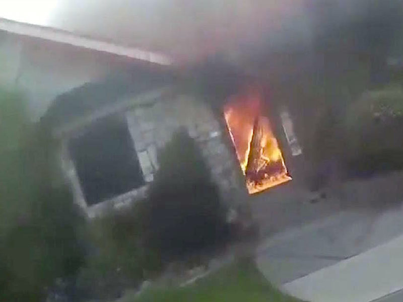 Garbage Collector Saves Elderly Couple Trapped Inside Burning House