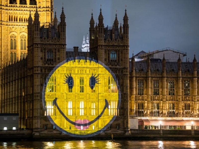 Smiley Face Projected Over Houses Of Parliament Building To Spread Joy To The Public